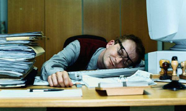 Person Sleeping on Desk